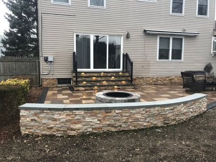 Back yard fire pit and wall of NJ